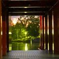 写真: 落合公園水の塔の柱の間から見えた夕焼け - 2
