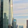Photos: 大名古屋ビルヂング5階「スカイガーデン」から見た景色 - 3:夕日を反射するスパイラルタワーズ