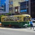 写真: 路面電車と運転士さん~長崎