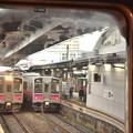 写真: 冷たい雨の秋田駅