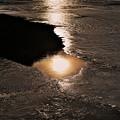 写真: 氷上の光