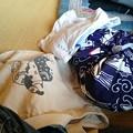 写真: 風呂敷にくるんで袋にいれて、風呂に入りにきた。withアキ。まずは昼ごはんから。Tシャツ、パンツを借りた。サウナ用のレンタル品。ここの