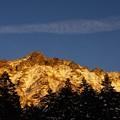 夕日に照らされる横岳