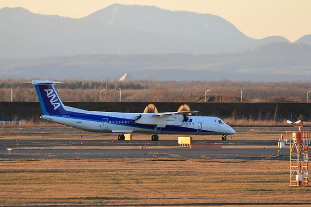 Q400 ANA Wings JA850A Propに夕陽うけ