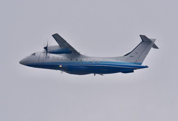 雨降りの嘉手納基地。。米空軍作戦コマンドドルニエC-146 上がり 20180109